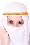 Attractive caucassian girl on the middle east. Beautiful young arabic woman Middle East in the national headdress, isolted over white image, isolated on the Royalty Free Stock Photos
