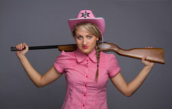 Attractive cawbow girl with shot gun over back stock photos