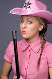 Attractive cawbow girl with shot gun over back royalty free stock images