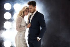 Attractive celeb couple posing on the stage. Elegant celeb couple posing on the stage royalty free stock photo