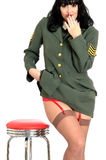 Attractive Cheeky Sexy Young Vintage Pin Up Model In Military Uniform With Suspender Belt and Stockings Stock Photography