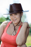Attractive cheerful Caucasian woman in cowboy hat Royalty Free Stock Photos