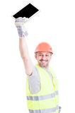 Attractive cheerful engineer rising up modern tablet Stock Photos