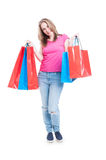 Attractive cheerful female  holding shopping or gift bags Stock Photography