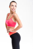 Attractive cheerful fitness girl in pink top and black leggings Stock Photography