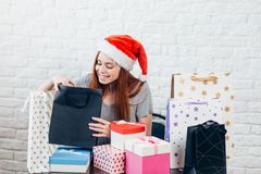 Attractive cheerful girl with Christmas gifts royalty free stock images