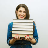 Attractive cheerful woman with books Royalty Free Stock Image