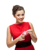 Attractive cheerful woman holding gift Royalty Free Stock Photo