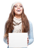 Attractive cheerful woman holding sign Stock Photos