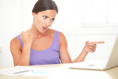 Attractive cheerful woman using her computer Stock Image
