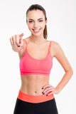Attractive cheerful young female athlete pointing on you Stock Images