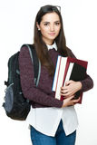 Attractive cheerful young female student holding books, isolated on white background. Royalty Free Stock Photography