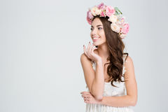 Attractive cheerful young woman in white dress and flower wreath Royalty Free Stock Images