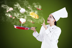 Attractive chef cooking with magic Royalty Free Stock Images