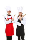 Attractive Chefs Isolated. A man and woman chef team isolated over white stock photos