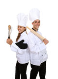 Attractive Chefs Isolated. A man and woman chef team isolated over white stock photography