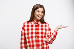Attractive chestnut woman in red and white shirt looks straight Royalty Free Stock Photo