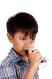 Attractive child drinking Stock Images