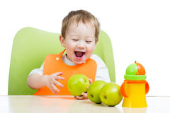 Attractive child with green apples healthy food Royalty Free Stock Image
