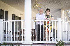 Attractive Chinese Couple Enjoying Their House Royalty Free Stock Images