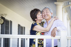 Attractive Chinese Couple Enjoying Their House Royalty Free Stock Photo