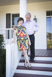 Attractive Chinese Couple Enjoying Their House Stock Photography