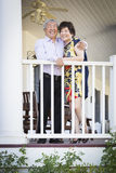 Attractive Chinese Couple Enjoying Their House Stock Image
