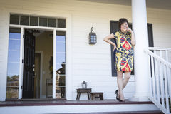 Attractive Chinese Woman On Her Front Porch Royalty Free Stock Images