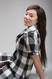Attractive chinese woman leaning backward. (gray background Stock Photos