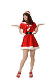 Attractive Christmas girl. Wear Santa Claus clothes open arms and feel surprised isolated on white Stock Images