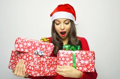 Attractive christmas woman looking to her presents on white background.  Royalty Free Stock Photo