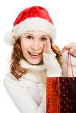 Attractive christmas woman in santa hat Stock Photography