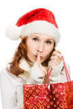 Attractive christmas woman showing silence gesture Stock Images