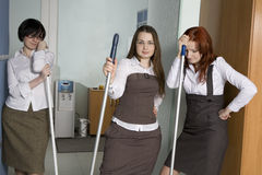 Attractive clerks washing the floor Royalty Free Stock Image
