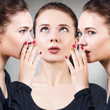 Attractive clone girls whispering Royalty Free Stock Images
