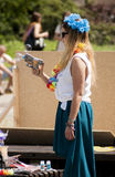 Attractive college girl shooting soap bubbles from toy gun Stock Photography