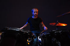 Attractive concentrated bearded man drummer playing his kit Royalty Free Stock Images