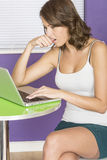 Attractive Concerned Confused Worried Biting Nail Young Woman Using Laptop Computer Royalty Free Stock Image