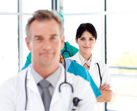 Attractive confident doctor in a line Stock Photo