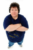 Attractive Confident Obese Older Woman. Attractive Confident Obese Forty-Five Year Old Woman with Headphones Standing Over White Background Royalty Free Stock Images