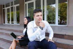 Attractive confident people, Caucasian boy and asian girl entrep Royalty Free Stock Images