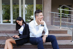 Attractive confident people, Caucasian boy and asian girl entrep Royalty Free Stock Photography