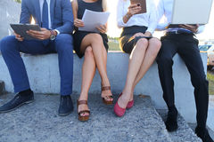 Attractive confident people, two boys and two girls, entrepreneu Stock Image