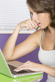 Attractive Confused Concerned Worried Biting Nail Young Woman Using Laptop Computer Royalty Free Stock Images