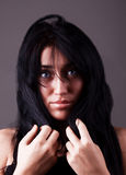 Attractive confused young woman with dark hair. Attractive confused young brunette with blue eyes Stock Photography