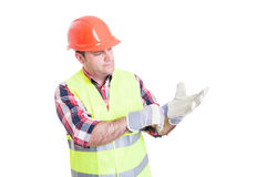 Attractive constructor adjusting his gloves Stock Image