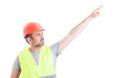 Attractive constructor man pointing finger up and showing someth Royalty Free Stock Photography
