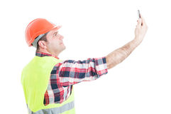 Attractive constructor taking a selfie with smartphone Stock Photo