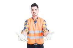 Attractive constructor wearing protection equipment waiting to r Stock Image