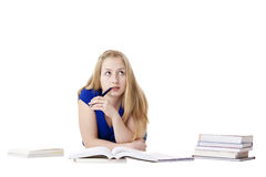 Attractive contemplative female student at floor Stock Images